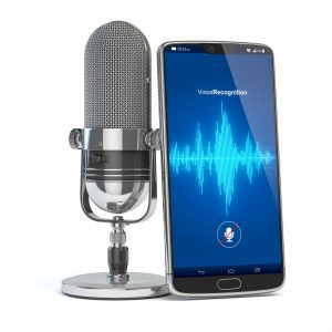 Voice Recognition concept. Microphone and smartphone or mobile phone with waves on the screen.